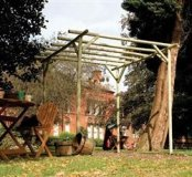 Cottingham traditional rustic pole pergola.