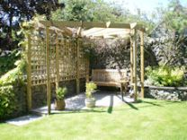 Copyright image: a lovely corner pergola with radiating rafters.