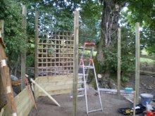 Copyright image: Corner pergola construction.