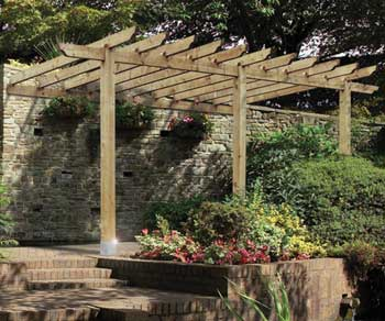 An attached lean-to pergola kit by Grange Fencing.  Use as a carport or patio pergola.