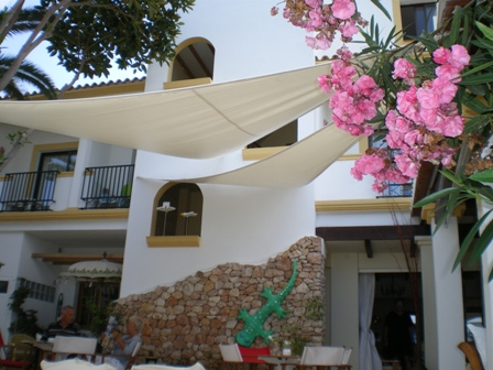 Copyright image: Shade sails secured to an attached lean-to pergola.