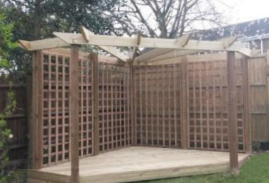 Copyright image: Chris's fantastic corner pergola made from the plans.