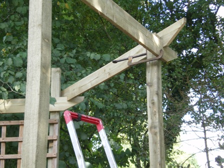 Copyright image: Corner pergola construction.
