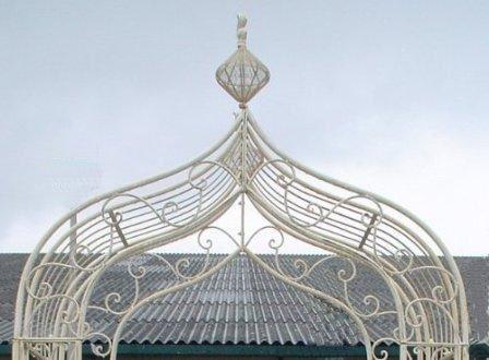 Intricate metal rose arch in cream.