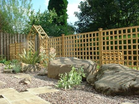 Copyright image: Recycled boulders used in a garden design.