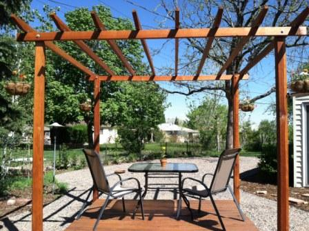 Copyright image: Jocelyn built this wonderful pergola with deck from the free pergola plans.