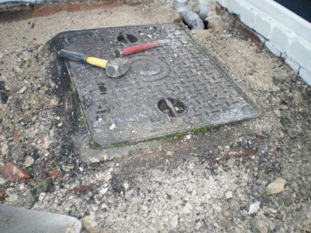 Copyright image:  Replacing drain covers.