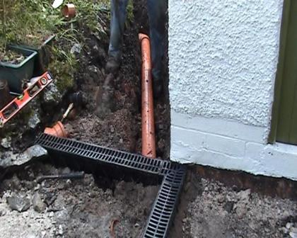 Copyright image:  Installing drains under the patio.