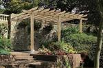 The lean-to pergola, sometimes called patio pergola, entry pergola, attached pergola or carport.