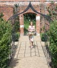 Ogee metal pergola walkway for creating a romantic, rose-covered walkway.