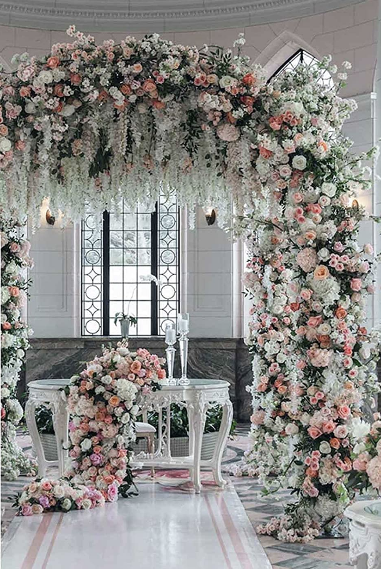 Metal rose arch used for a romantic wedding  bower.