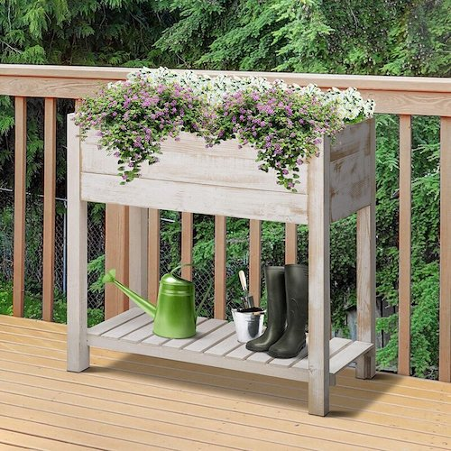 Lovely wooden raised bed with a shelf.