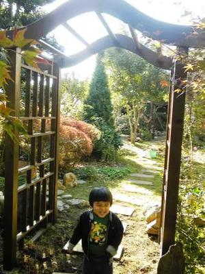 Hiromu Under the Curved Garden Arch
