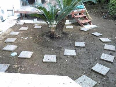A garden makeover project: laying the tiles.