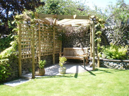 Copyright image:  A corner pergola and patio combination.