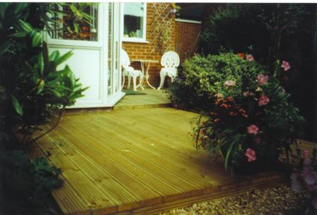 Copyright image: Split level decking as a small garden design project.