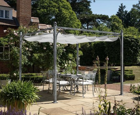 Gorgeous metal pergola with retractable canopy over a beautiful metal dining set.