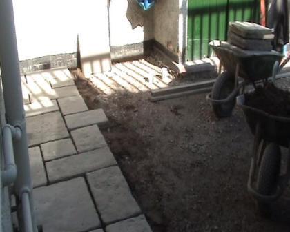 Copyright image:  Laying paving slabs.