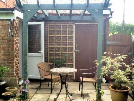 Copyright image: A lovely patio pergola build from the lean-to pergola plans