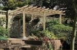 The lean-to pergola, sometimes called patio pergola, entry pergola, attached pergola or carport.