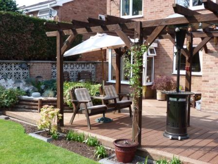 Copyright image: A fantastic attached lean-to pergola with garden seat.