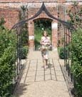 Ogee metal pergola walkway for creating a romantic, rose-covered walkway.